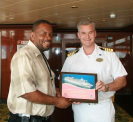 benoit_bardouille_receives_plaque_from_ship_captain__jan_2008.jpg