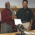 hon_ambrose_george_with_ian_singh_of_dipcon_engineering_services_limited.jpg