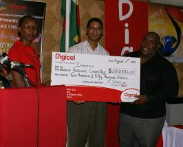 digicel_presents_cheque_13wcmf_launch.jpg