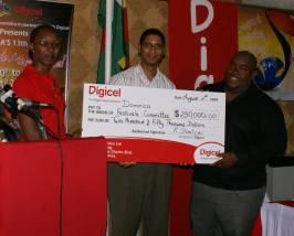 digicel_presents_cheque_13wcmf_launch.jpg