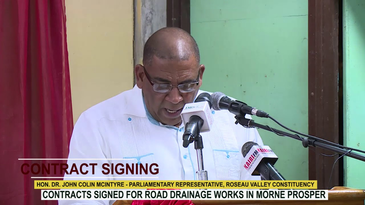 HON. DR. JOHN COLIN MCINTYRE ADDRESSES CONTRACT SIGNING CEREMONY IN MORNE PROSPER 6