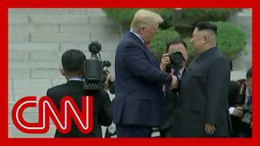 Trump and Kim Jong Un shake hands at DMZ 10