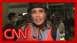 CNN reporter describes 'chaos' as riot police charge protesters 6