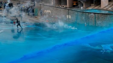 Hong Kong police spray protesters with blue-dye water cannons 6