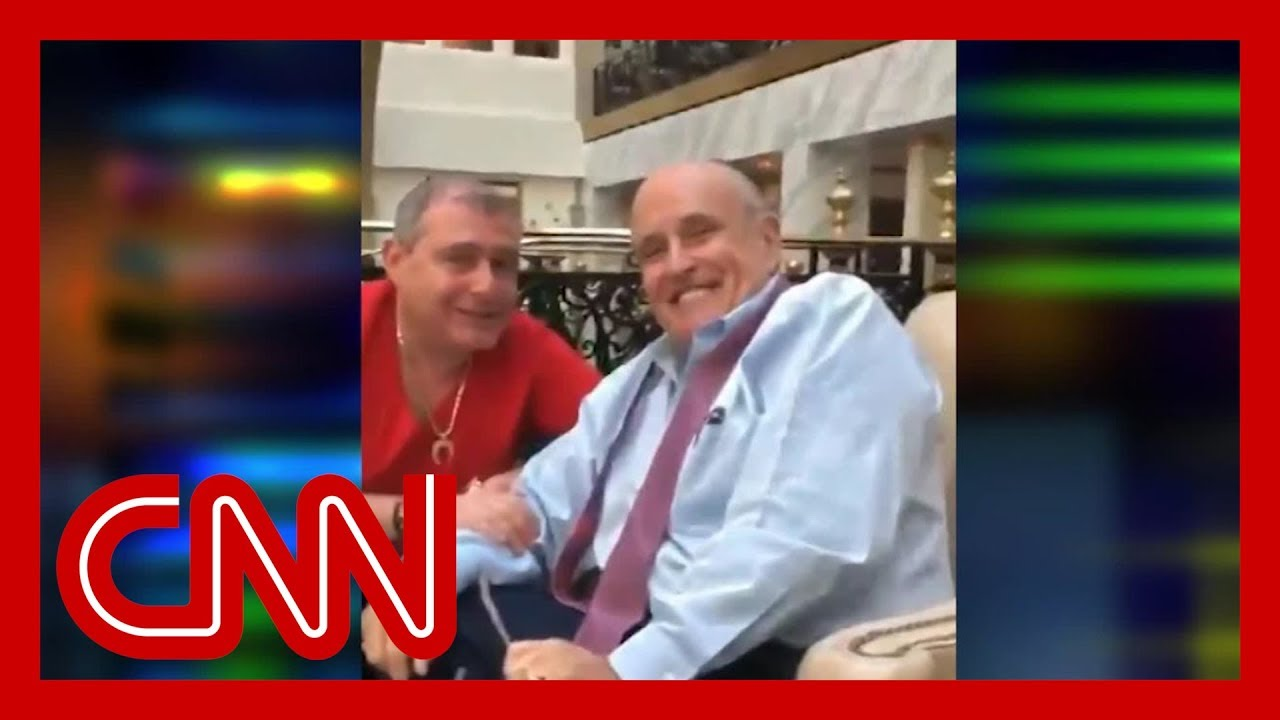 Video shows Rudy Giuliani with arrested associates 7