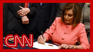 Pelosi signs impeachment articles against President Trump 6