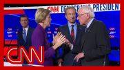 Watch tense exchange between Warren and Sanders after debate 3