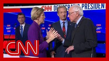 Watch tense exchange between Warren and Sanders after debate 6
