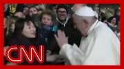 Watch Pope Francis smack woman's hand after being grabbed 3