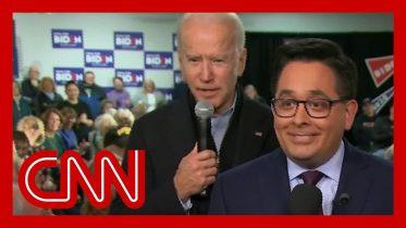 Joe Biden creeps up behind reporter in photobomb attack 6