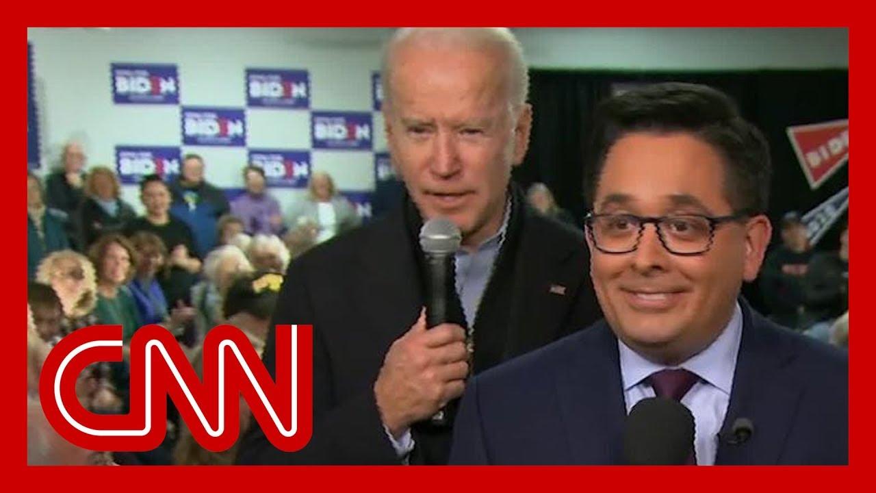 Joe Biden creeps up behind reporter in photobomb attack 8
