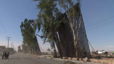 Strong winds blew over parts of Trump's new border wall with Mexico 6