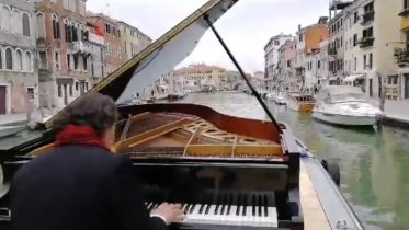Italian pianist Paolo Zanarella performs while sailing down Venice canal 10
