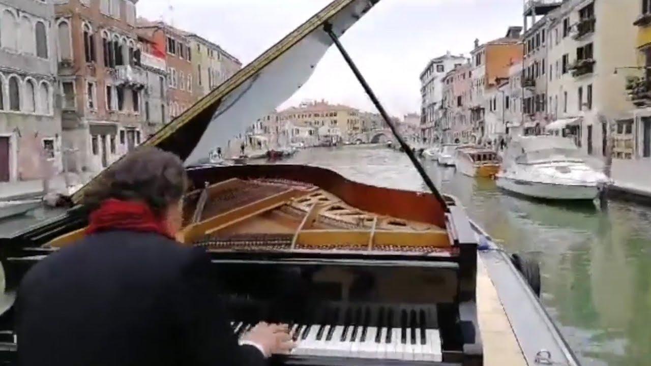 Italian pianist Paolo Zanarella performs while sailing down Venice canal 1