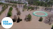 Aerial drone shows massive flooding in Michigan | USA Today 2
