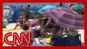 CNN reporter debunks Alabama beachgoers' Covid 19 theories 5