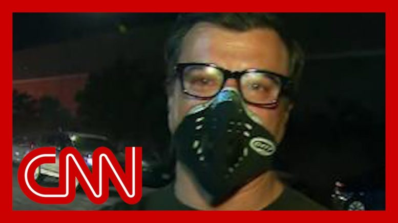 Reporter hit with tear gas: That's a healthy dose 1