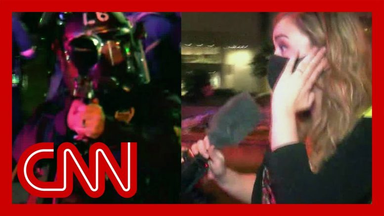Officer fires pepper balls at reporter 1