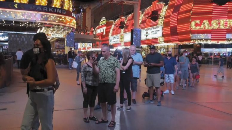 Gamblers gather for Vegas casinos reopening 1