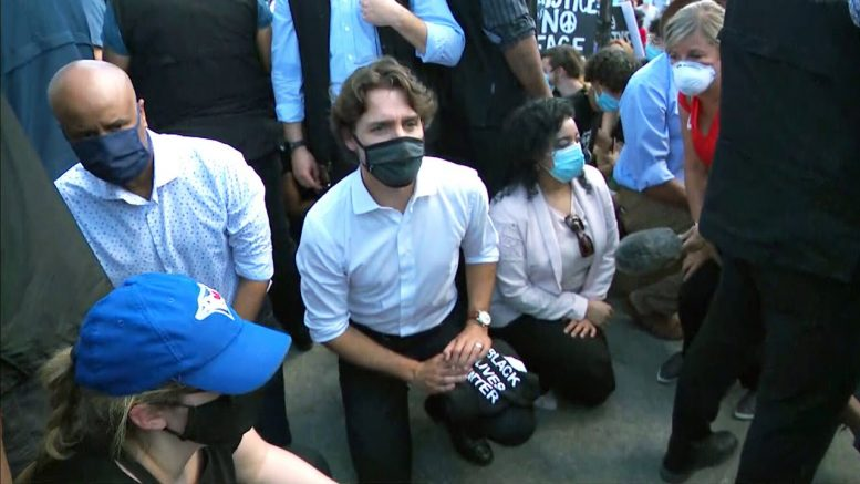 'An empty symbolic gesture': activist on Trudeau kneeling at protest 1