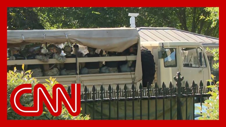 Military vehicles move outside White House amid protests 1