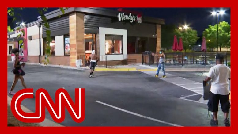 CNN crew harassed and camera broken during protest 1
