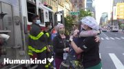 Nurse and firefighter share emotional embrace | Humankind 3