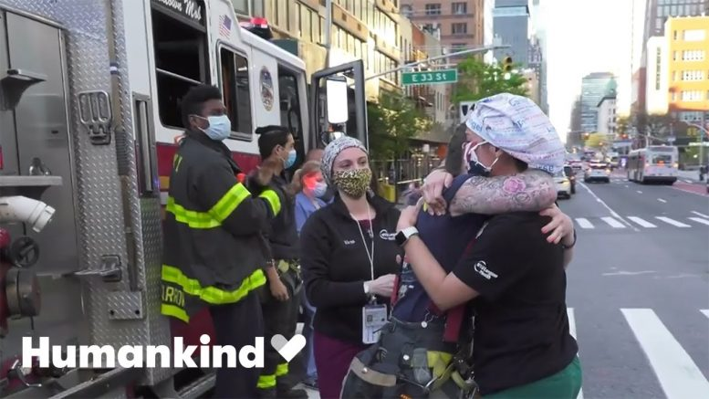 Nurse and firefighter share emotional embrace | Humankind 1