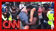 Black Lives Matter demonstrator carries injured white protester to safety in powerful image 4