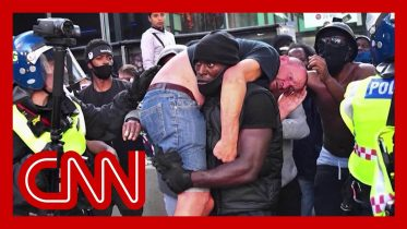 Black Lives Matter demonstrator carries injured white protester to safety in powerful image 6