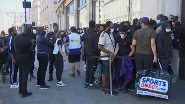 Long lines spotted in front of reopening stores in the U.K. 6