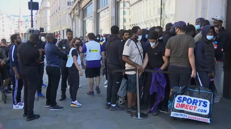Long lines spotted in front of reopening stores in the U.K. 1