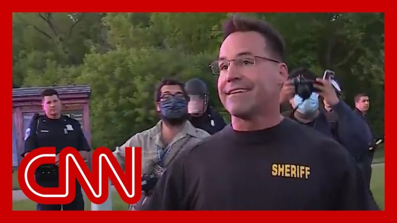 Sheriff takes off riot gear and joins peaceful protesters 1