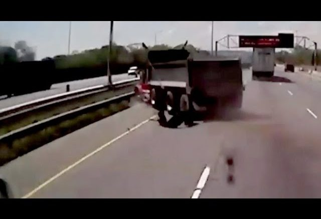 WATCH: Truck blows a tire and spins out of control on this busy Ontario highway 1