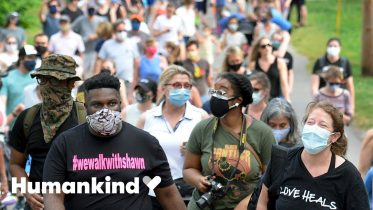 Neighbors fight fear by walking together | Humankind 6