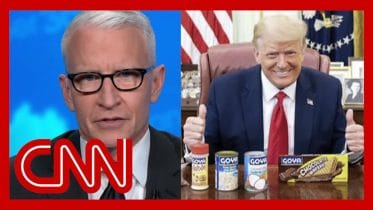 Cooper: Trump poses with can of beans while Covid-19 surges 6