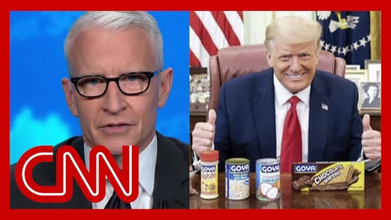 Cooper: Trump poses with can of beans while Covid-19 surges 1