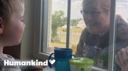 Toddler gets the giggles when grandparents visit window | Humankind 3