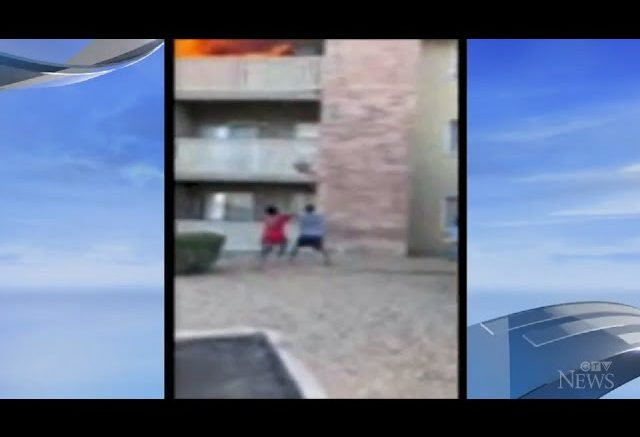 Watch: Man makes life-saving catch as mother throws young son from burning balcony in Arizona. 1