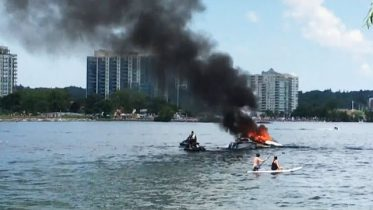 Four people rescued from a burning boat in Barrie, Ont. 1