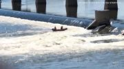 Caught on cam: Dramatic rescue of a person clinging to dam 1