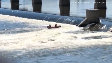Caught on cam: Dramatic rescue of a person clinging to dam 6