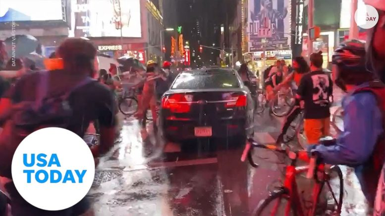 Car plows through group of protesters in Time Square | USA TODAY 1