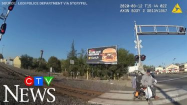 Caught on cam: Man in wheelchair saved from oncoming train 6