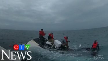 Caught on cam: Boaters rescued after their boat capsizes 5