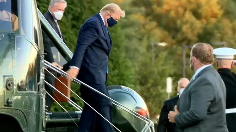 WATCH: President Trump seen getting off helicopter at Walter Reed Hospital 1