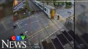 Caught on cam: Reckless pedestrian nearly hit by train 2