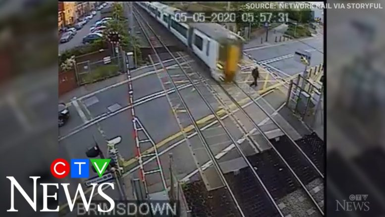 Caught on cam: Reckless pedestrian nearly hit by train 1