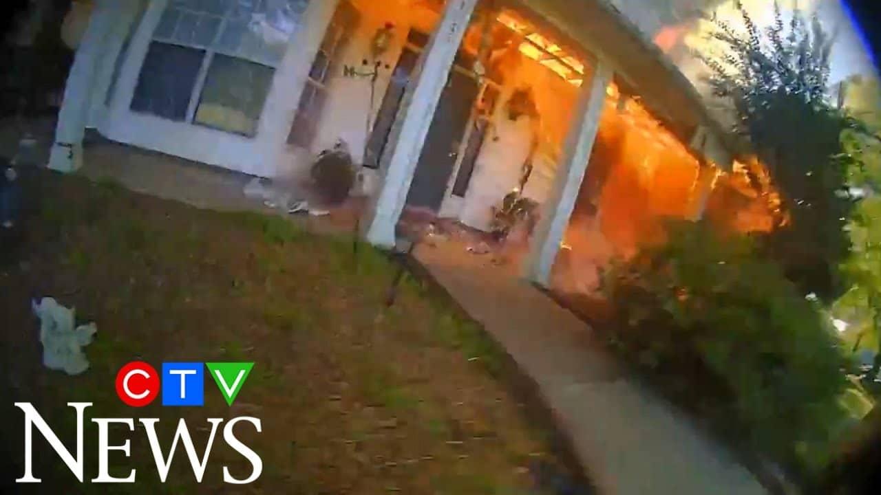 Arkansas officer runs into burning house 6