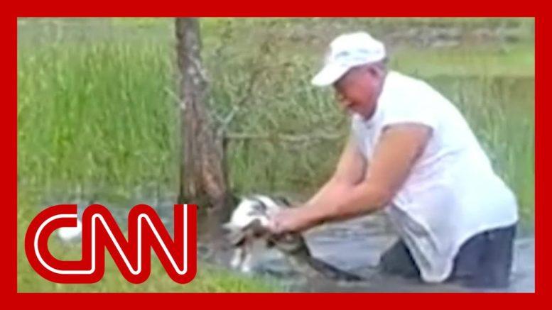 Florida man saves puppy from alligator 1